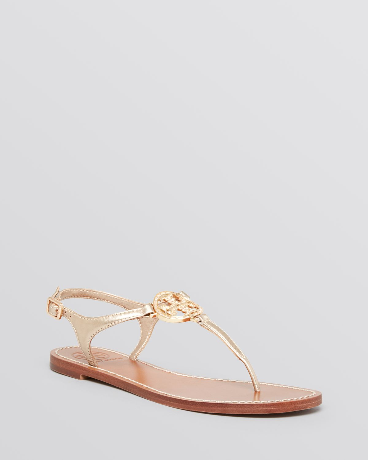 8486fa7d078f Lyst - Tory Burch Flat Thong Sandals - Violet Logo in Metallic