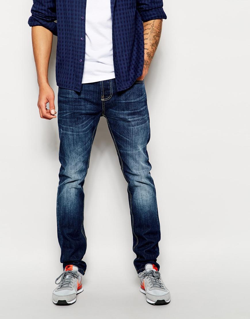 bellfield mid wash blue jeans in tapered fit in blue for men lyst. Black Bedroom Furniture Sets. Home Design Ideas