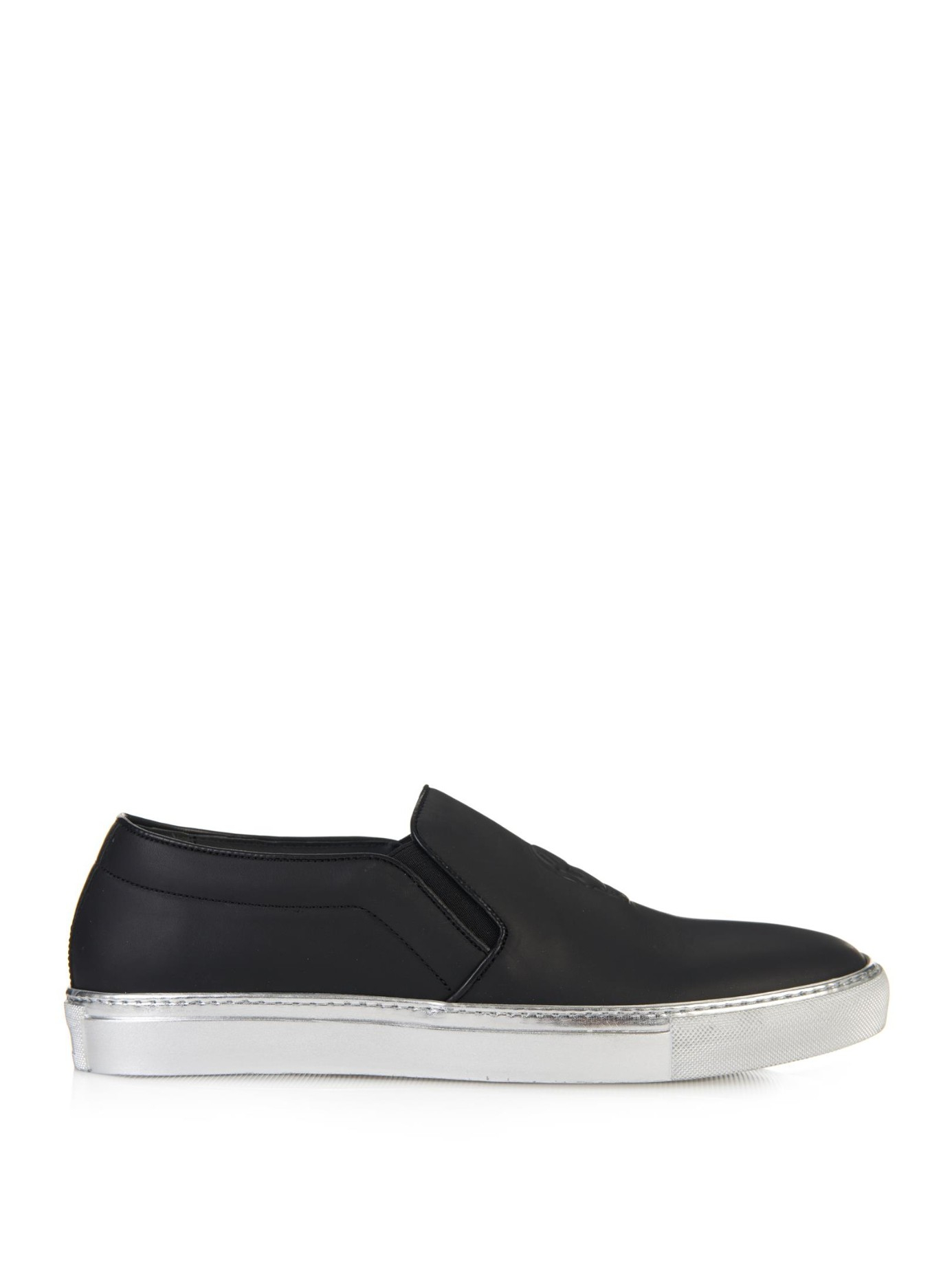 Alexander mcqueen skull embossed leather slip on trainers in black for