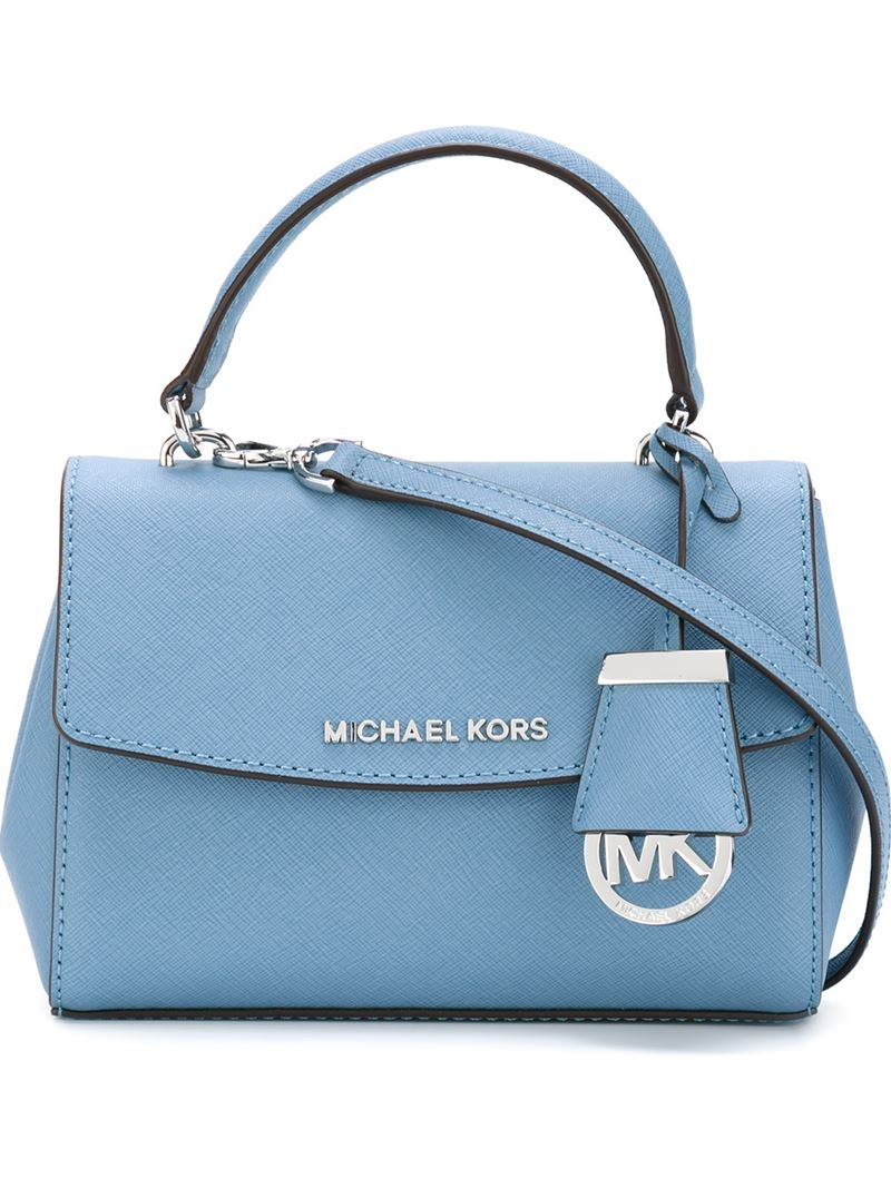 76776c40a34d ... official lyst michael michael kors extra small ava crossbody bag in  blue 9fbf6 c2b2c