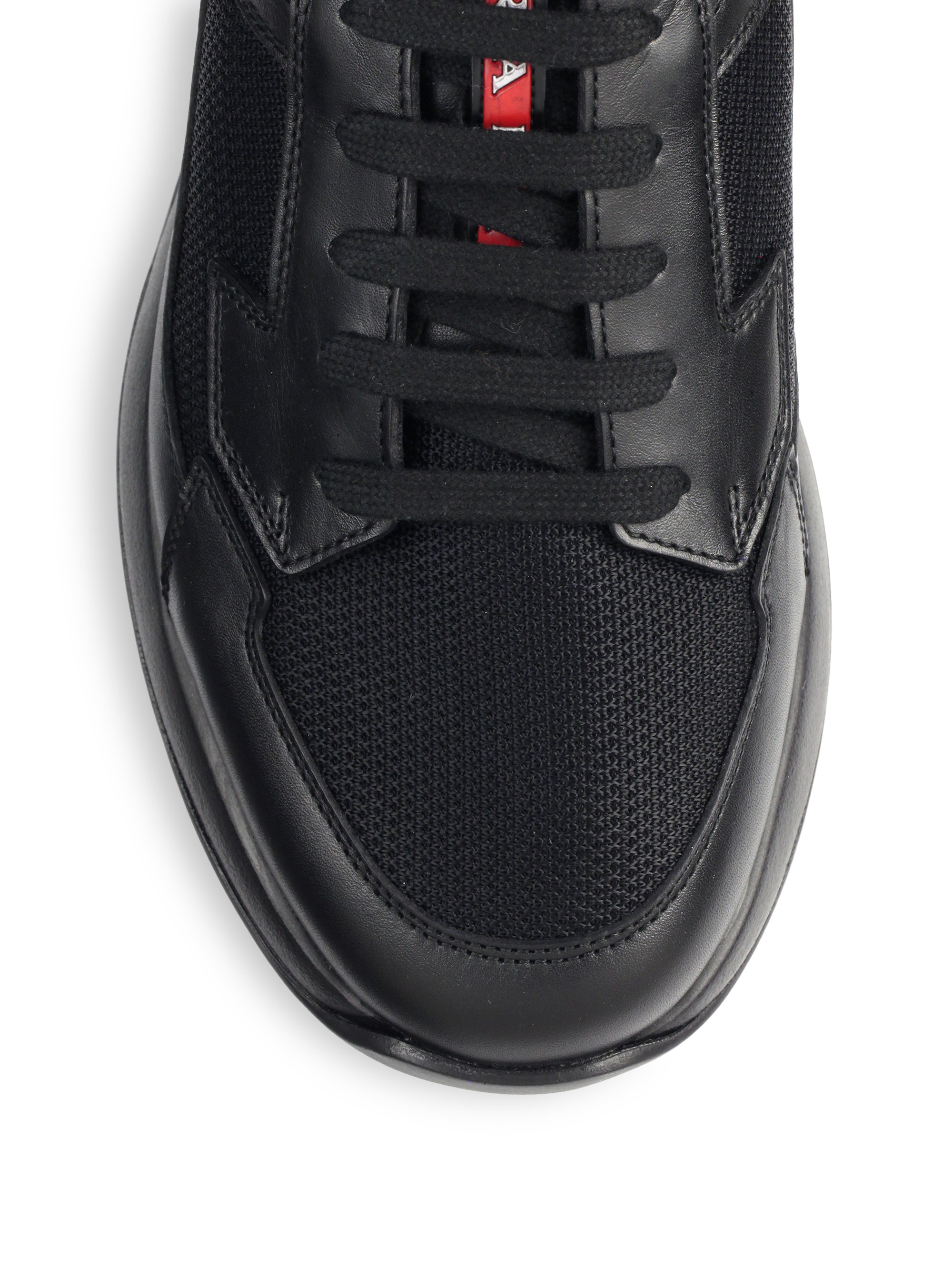 3140e5ac1d88 ... promo code for lyst prada leather running sneakers in black for men  69b4f 54efd