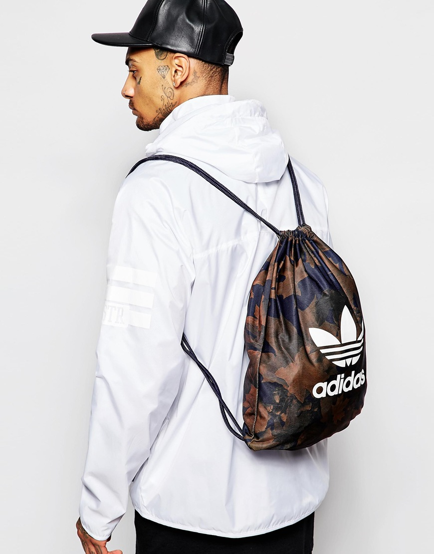 Lyst - adidas Originals Drawstring Backpack In Camo Ax6315 in Green ... 3f3e644126