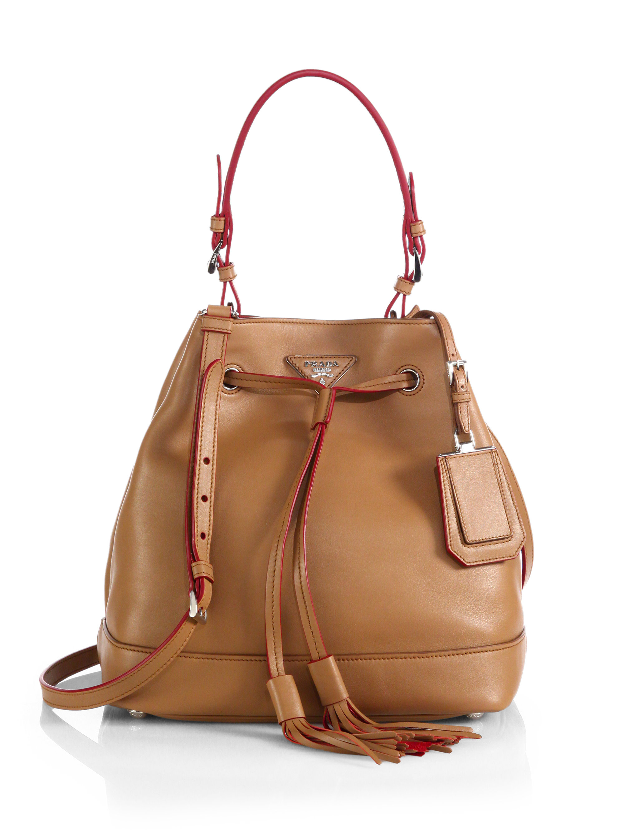 This seasonless bucket bag carries posh style in Italian leather or suede. Generous pockets, front and back, ensure essentials are always close at hand. Open top with post-and-hole closure. Slit pockets front and back; magnetic closure. Interior pocket. Adjustable cross-body strap. Leather or suede; unlined.