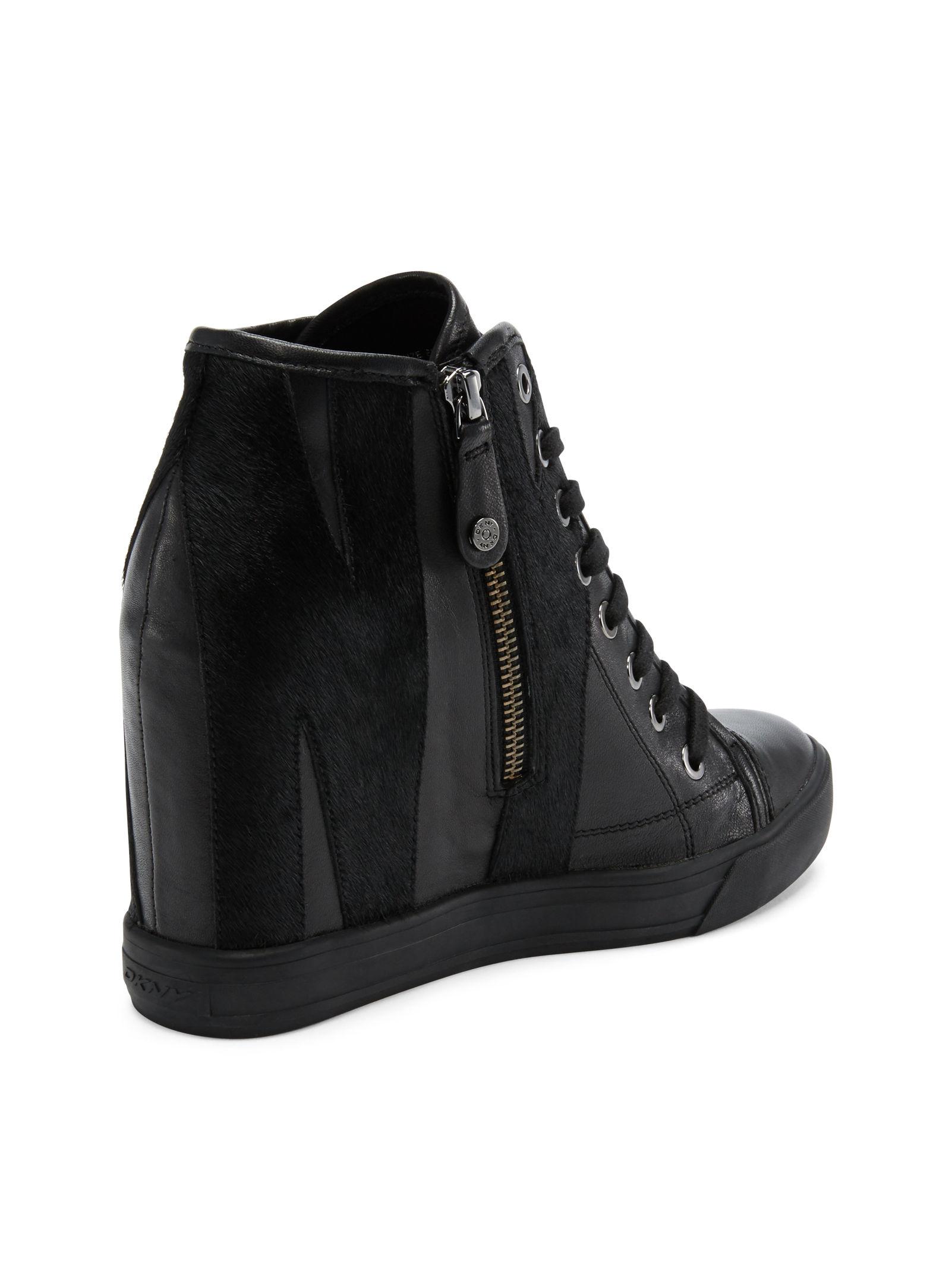 5cfcc79f12c6 Lyst - DKNY Grommet Zip Wedge Sneaker in Black
