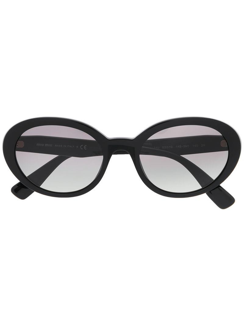 9a5e7613d143 Lyst - Miu Miu Round Frame Sunglasses in Black