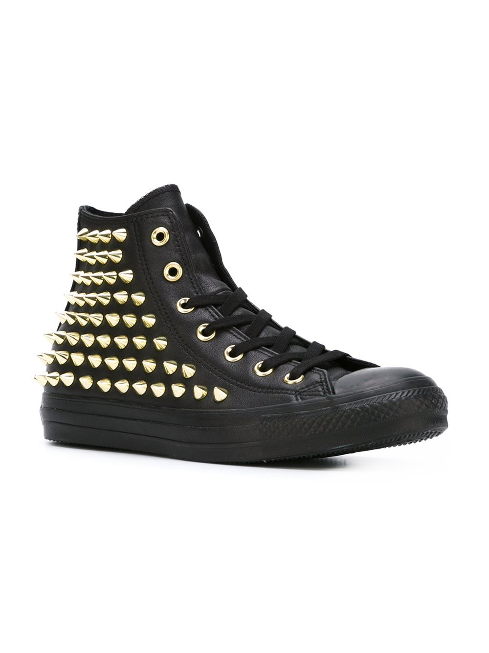 Studded sneakers kick up your kicks and show your sense of style. These fun, vibrant, blingy sneakers come in a variety of styles and colors, including black suede with silver studs across the toes, colorful studded canvas, and funky metallic leather.
