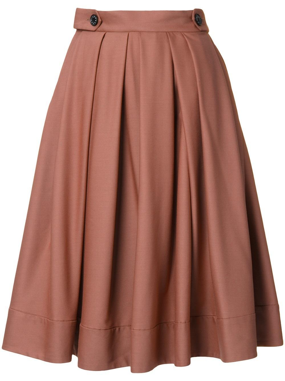loveless mid rise pleated skirt in brown lyst