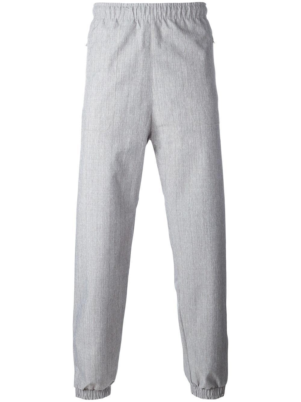 lyst adidas originals wind track pants in gray for men