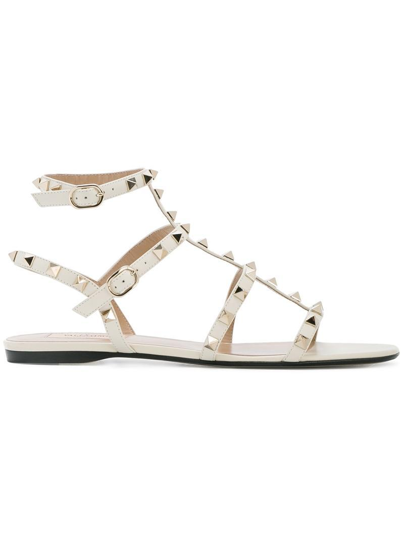 a9344f42d54 Valentino Rockstud Flat Leather Thong Sandal in White - Save ...
