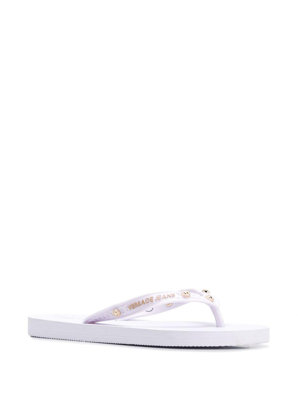 6c8805d71 Lyst - Versace Jeans Studded Flip Flops in White