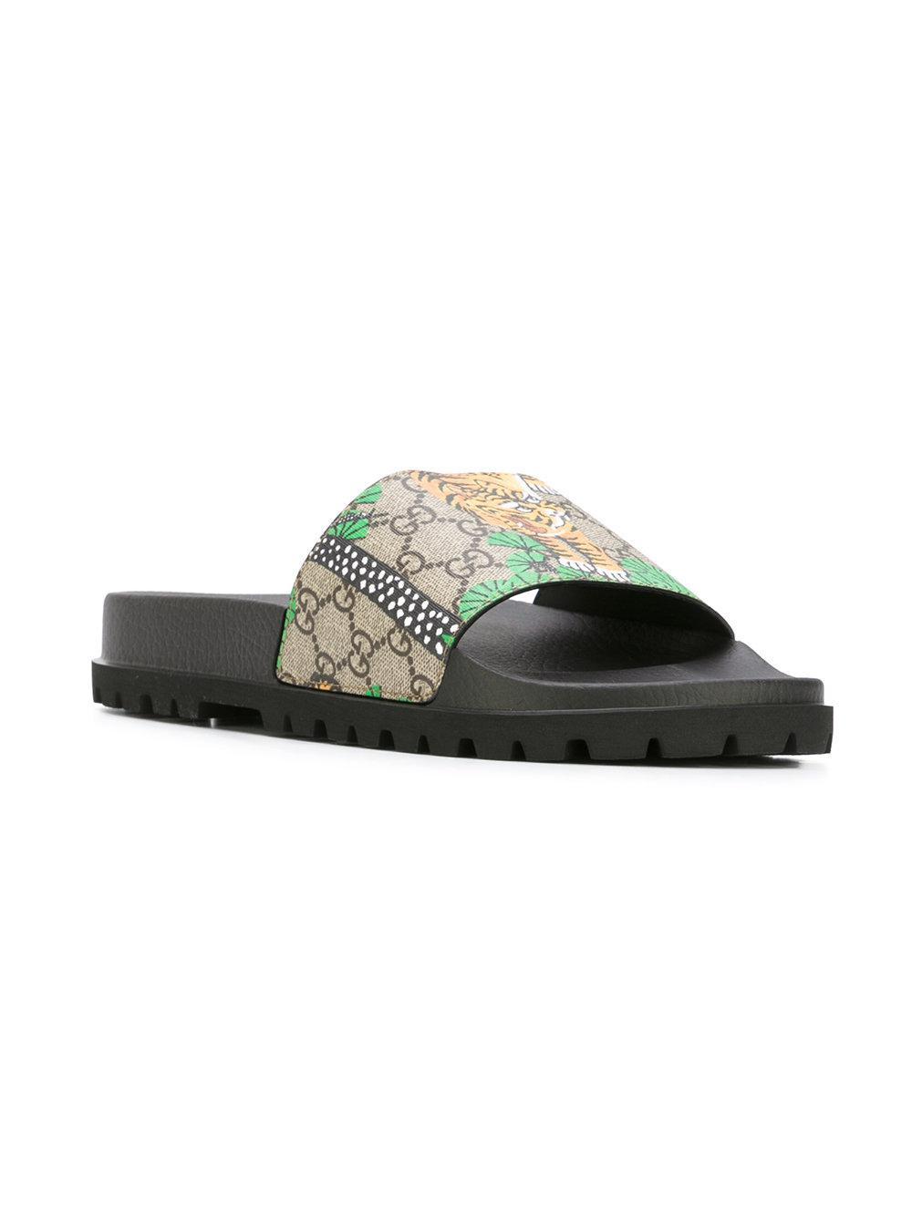 05153b275c0 Lyst - Gucci GG Supreme Tiger Slides in Black for Men
