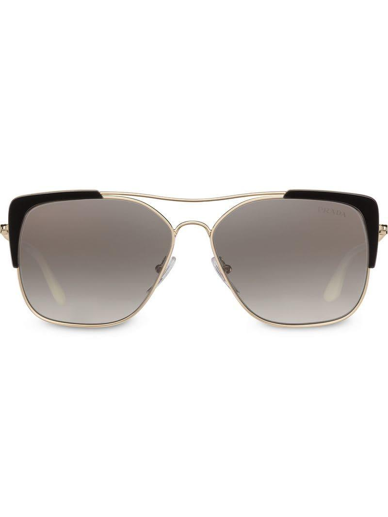 4503087a3370b Lyst - Prada Cat Eye Sunglasses in Metallic
