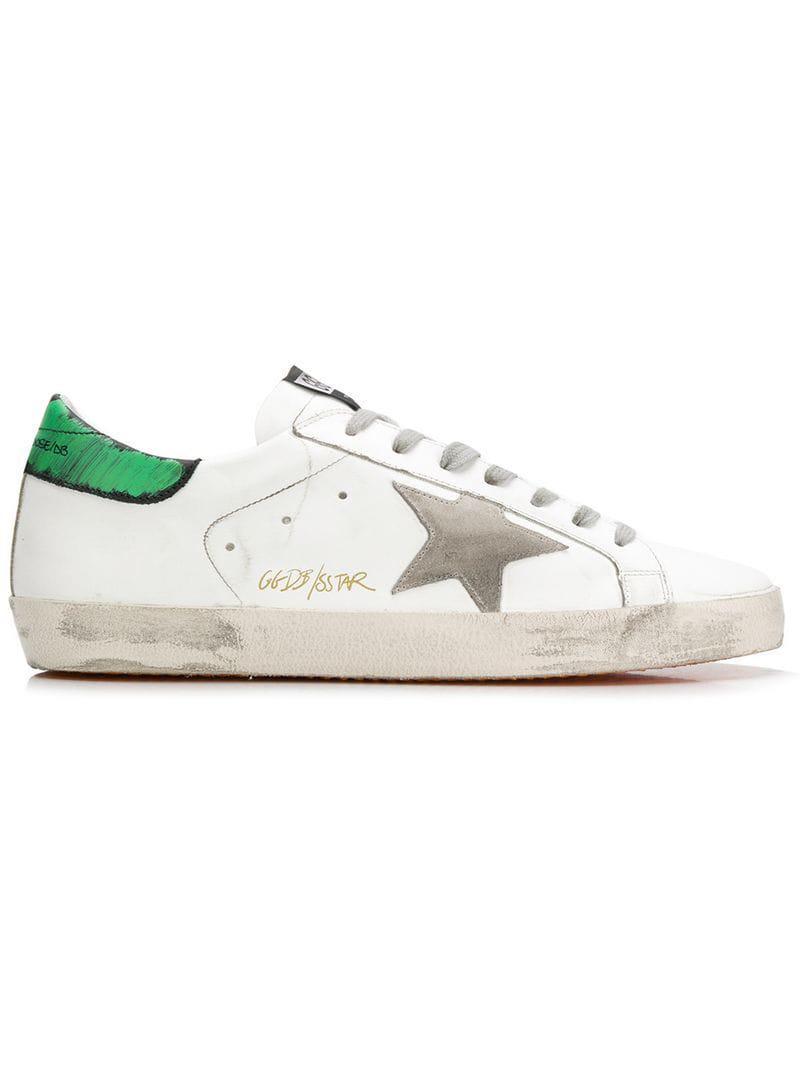 468959475d63 Golden Goose Deluxe Brand. Men s White Superstar Distressed Sneakers