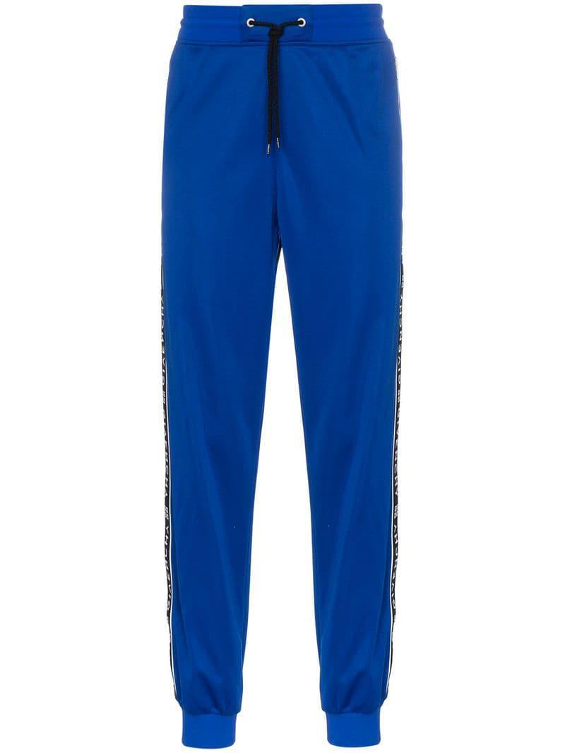 a1585bf5d27 Lyst - Pantalon de jogging à bandes logo Givenchy pour homme en ...