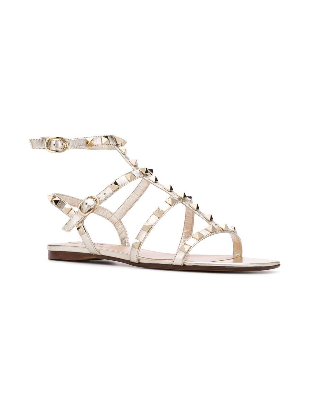 bf99e9f0ee2 Lyst - Valentino Garavani Rockstud Ankle Strap Sandals in Metallic