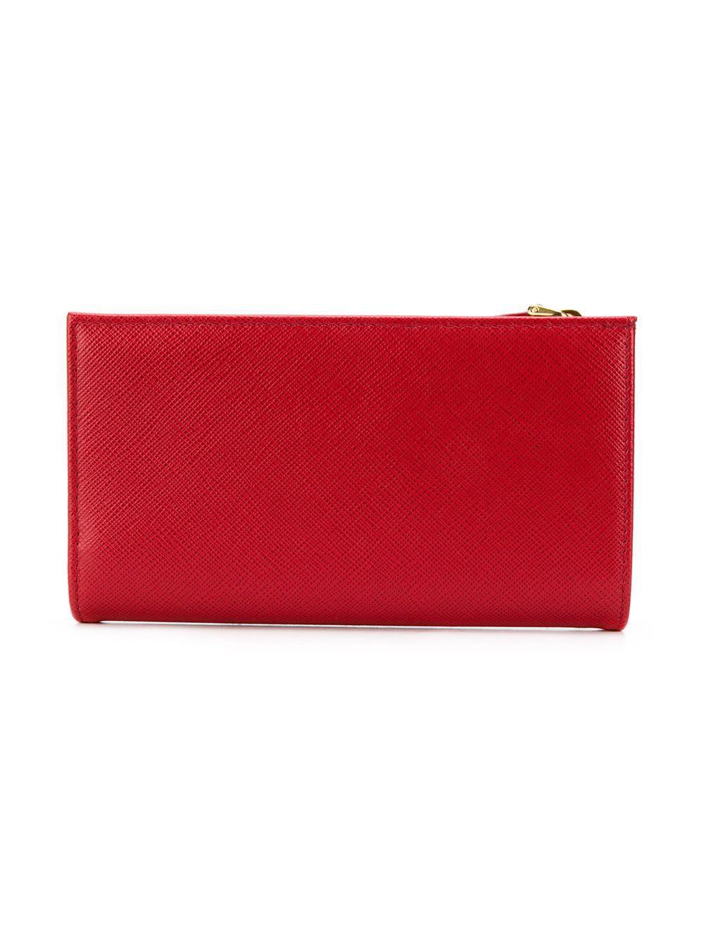 6d6a357fa44bf8 Prada Saffiano Slim Wallet in Red - Lyst