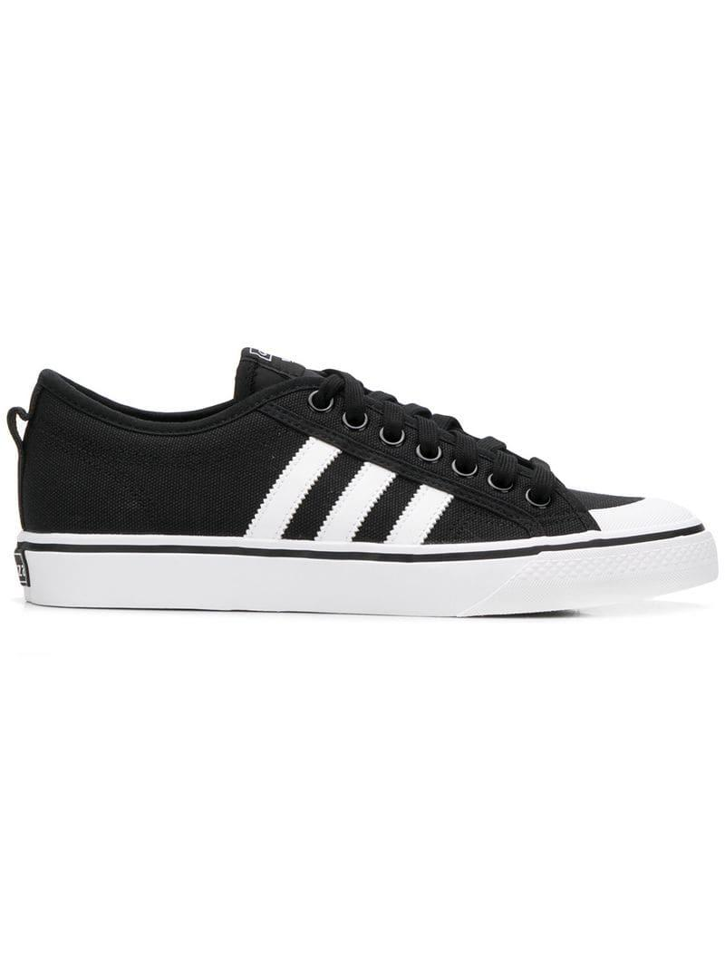 buy popular 097fc dc86b adidas. Men s Black Nizza Sneakers