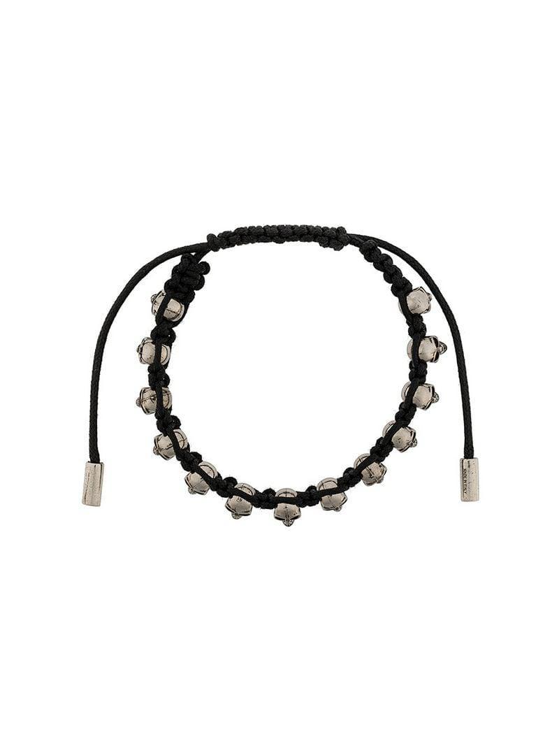 b779cfb10c09 Alexander McQueen - Black Pulsera con charm de calaveras for Men - Lyst.  Ver en pantalla completa