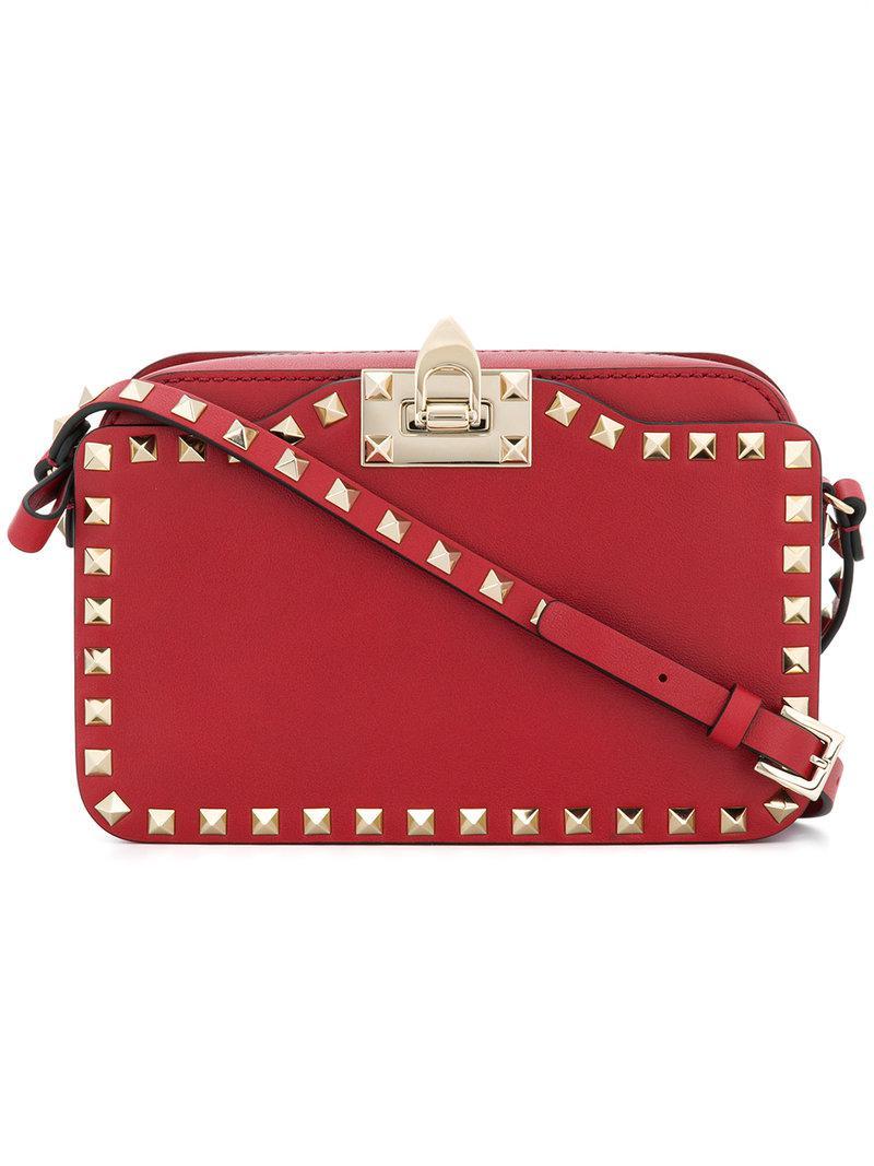 5c04a42c4637 Lyst - Valentino Garavani Rockstud Crossbody Bag in Red
