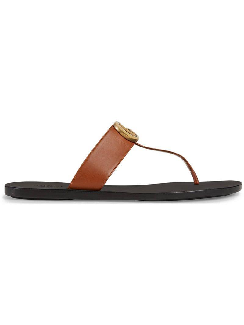 a1622bbcd3a0 Lyst - Gucci Leather Thong Sandal With Double G in Brown