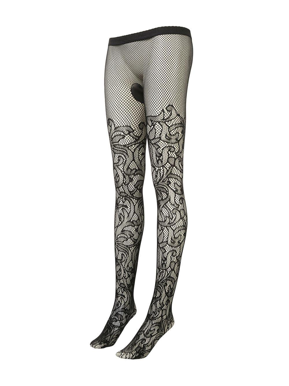 2d1d60276 Lyst - Wolford Floral Fishnet Tights in Black