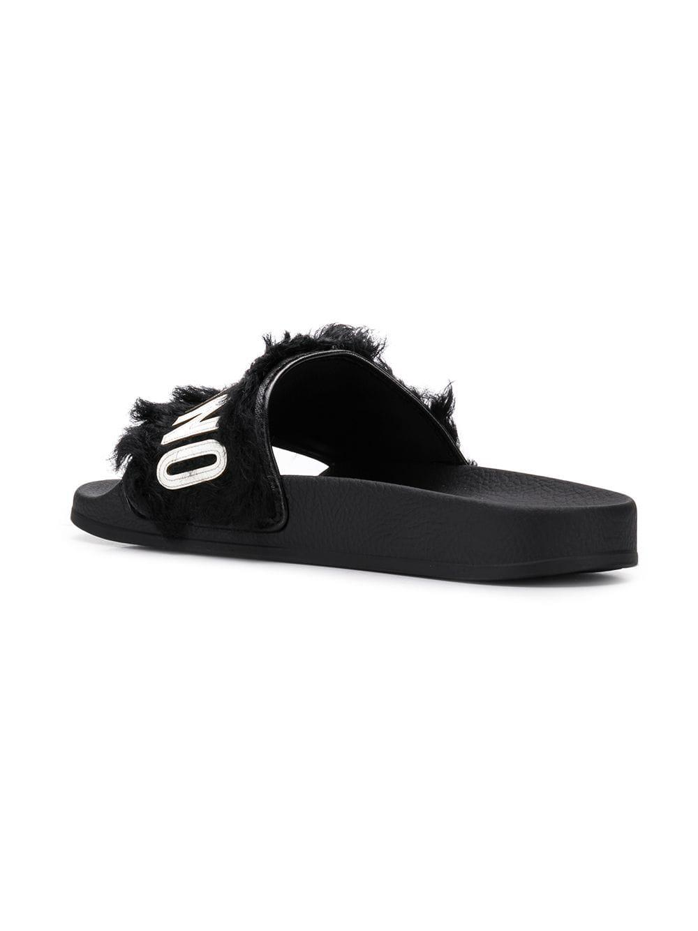 1ea2c340374 Moschino Logo Furry Slippers in Black - Lyst