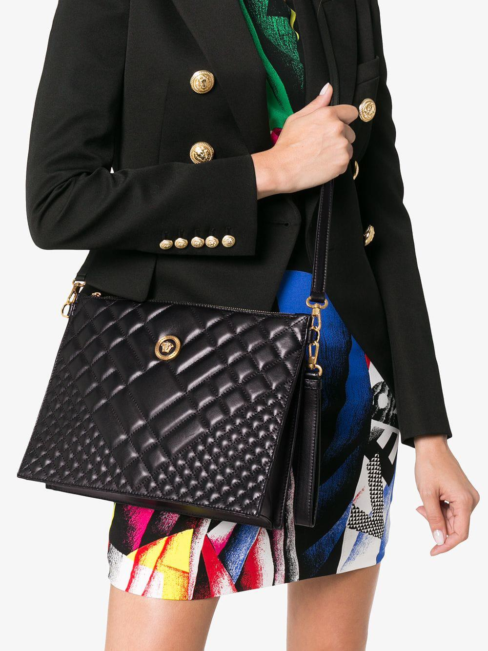 12632baabd9c Lyst - Versace Black Medusa Quilted Leather Clutch Bag in Black - Save 28%