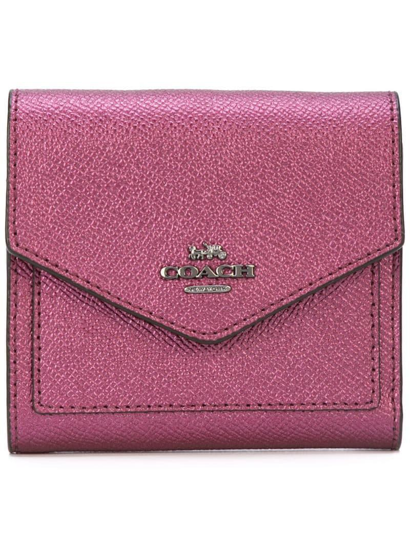 b676b3a9056e ... sale lyst coach metallic small wallet in red b66bc ace73