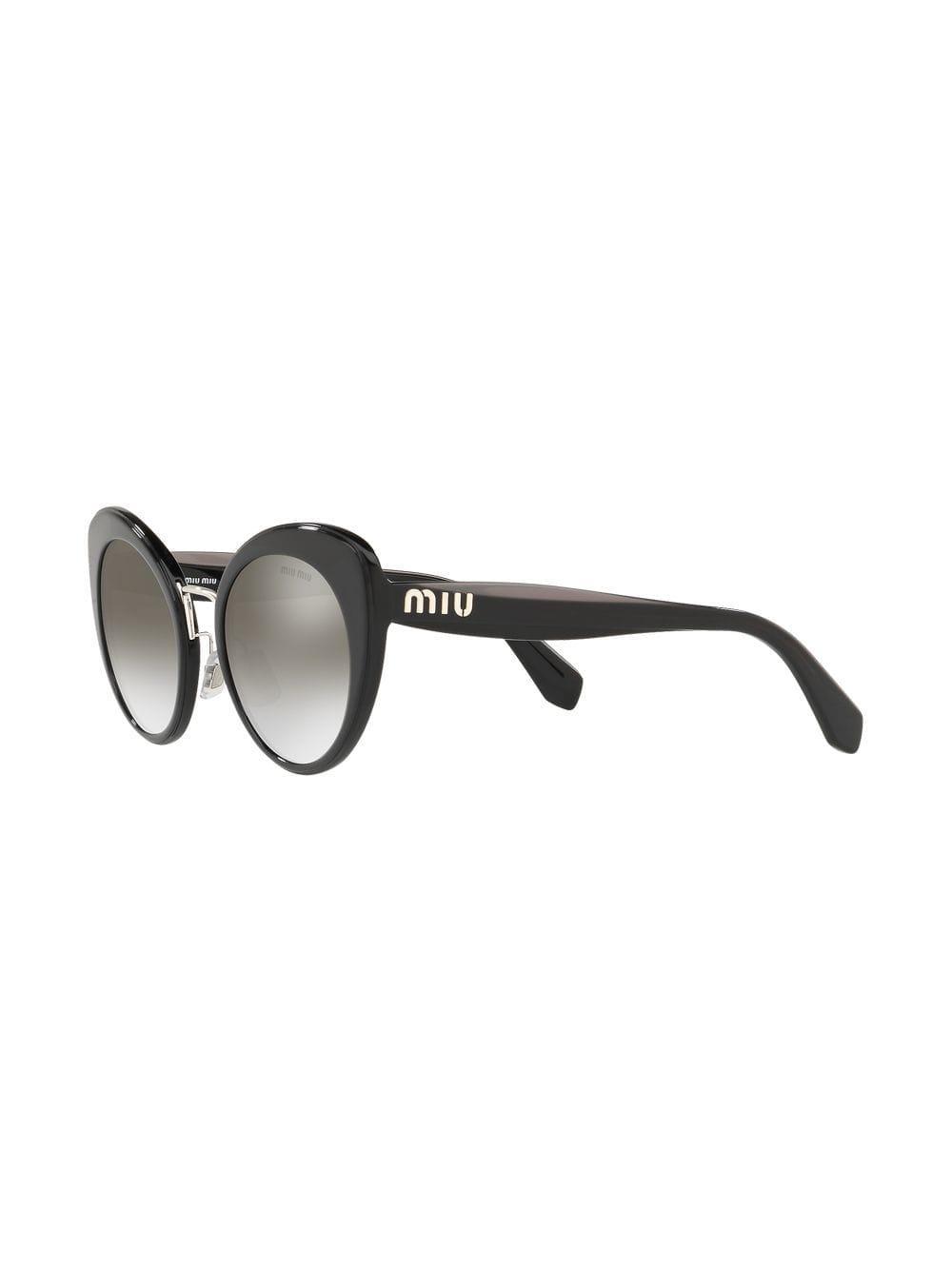076ed4135f0 Miu Miu Cat Eye Sunglasses in Black - Lyst