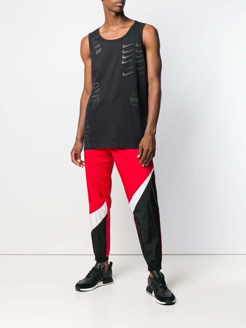 1464b4ae9718 Nike - Red Logo Track Pants for Men - Lyst. View fullscreen