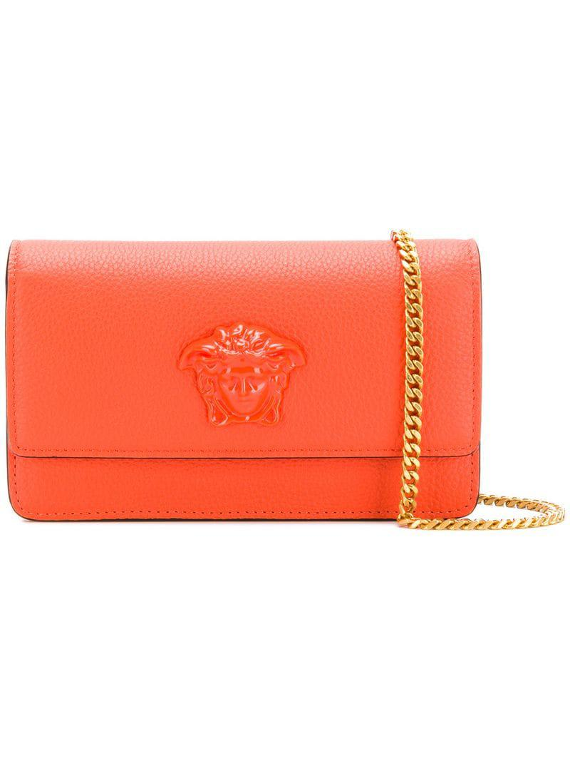 3c1850494f3b Lyst - Versace Medusa Head Clutch Bag in Orange