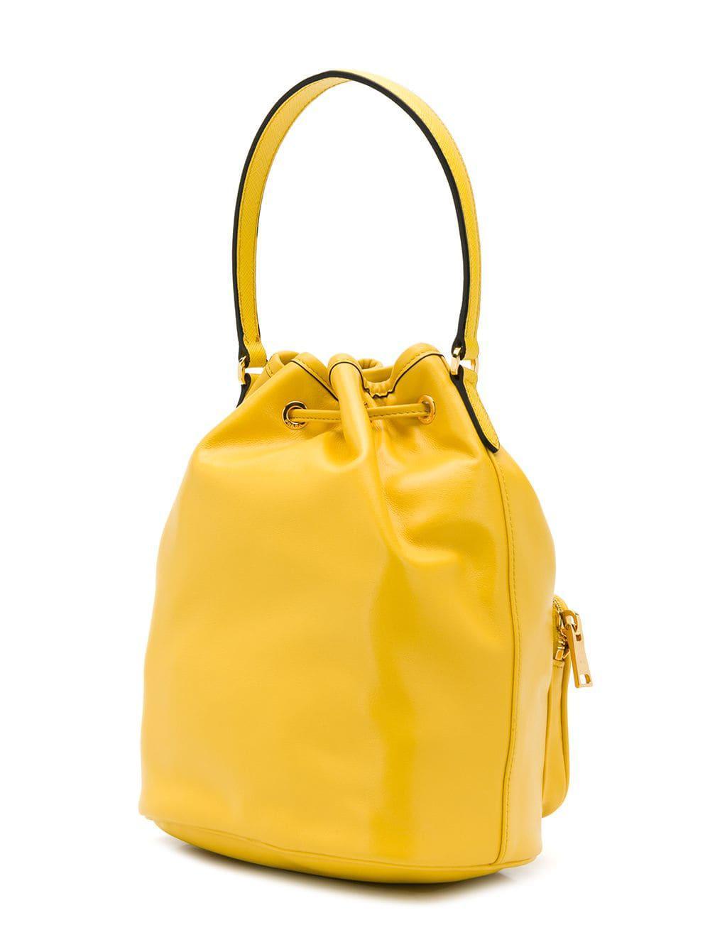 4d8dbd2e3a ... germany prada yellow logo plaque bucket bag lyst. view fullscreen d56dd  fa1aa