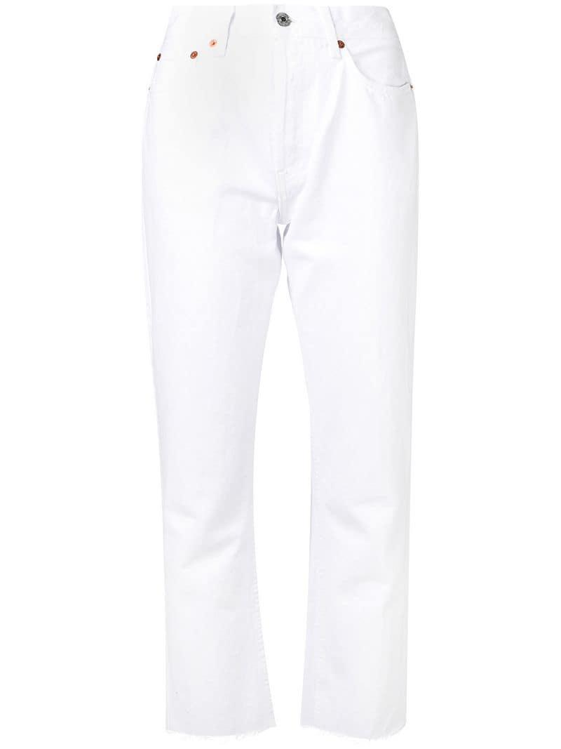 d2af938563bd4 Lyst - RE DONE Stove Pipe Jeans in White