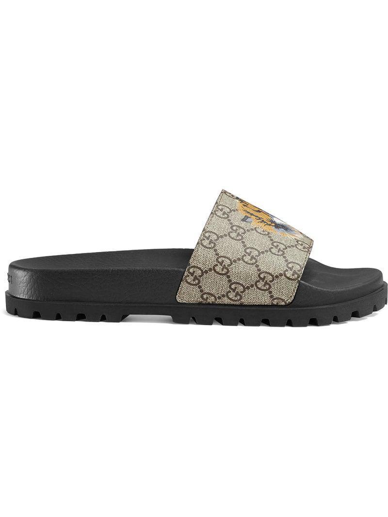 130ac8e12dd Gucci - Brown GG Supreme Tiger Slide Sandal for Men - Lyst. View fullscreen