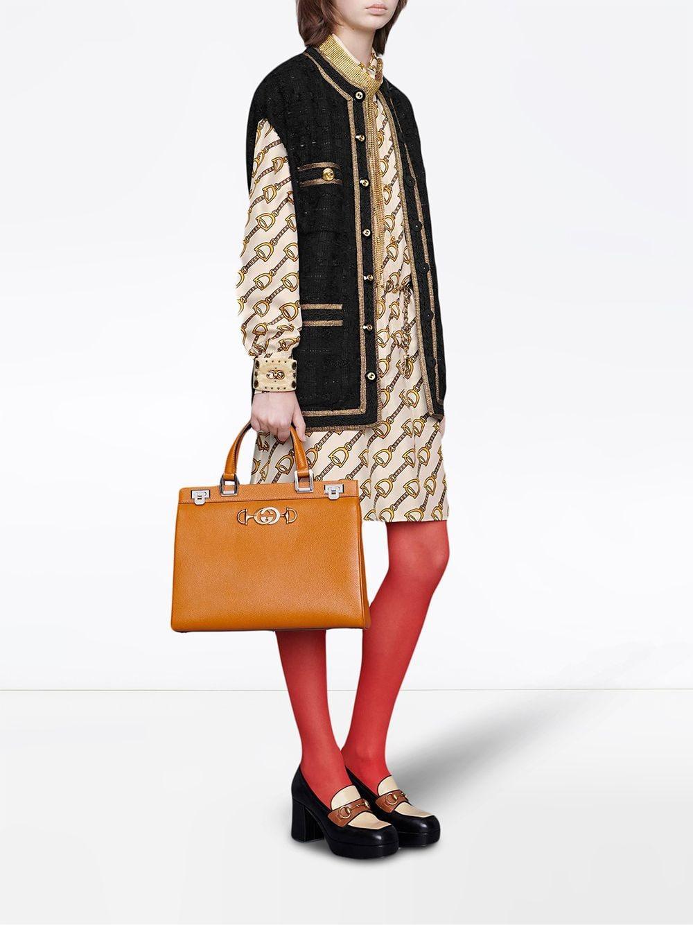 0af47368f Lyst - Gucci Silk Dress With Stirrups Print