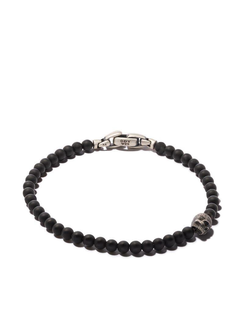 73e79eb0c446 Pulsera Spiritual Beads con ónix negro y calavera de plata David ...