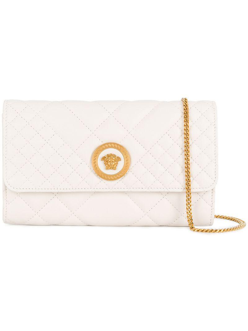 32bf997ab3 Lyst - Versace Quilted Medusa Clutch Bag in White