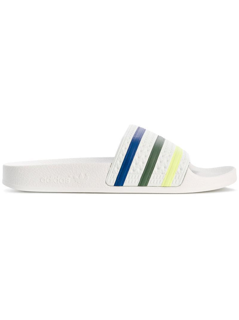 d022541a2093df adidas Adilette Pride Slides in White - Lyst