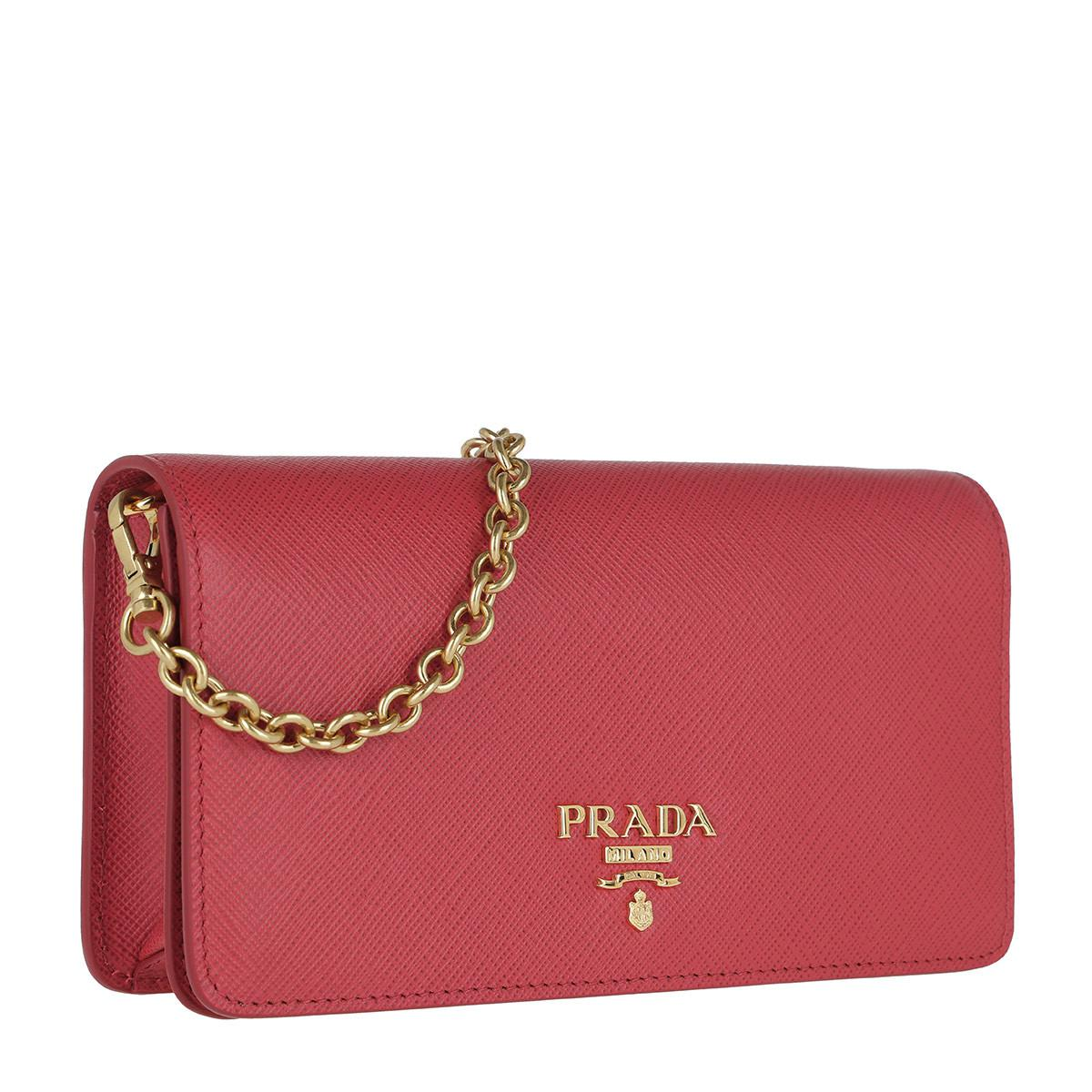 9c3b0adf63 ... discount prada red logo wallet on chain saffiano leather peonia lyst.  view fullscreen 91a18 0b180