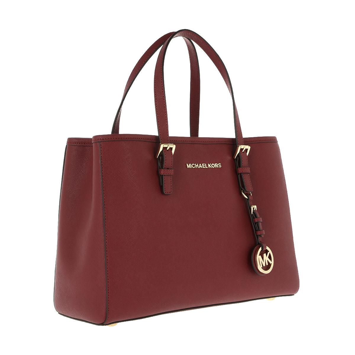 7185e7b59c ... germany michael kors jet set travel md ew tote mulberry in red lyst  5d7b6 5f251