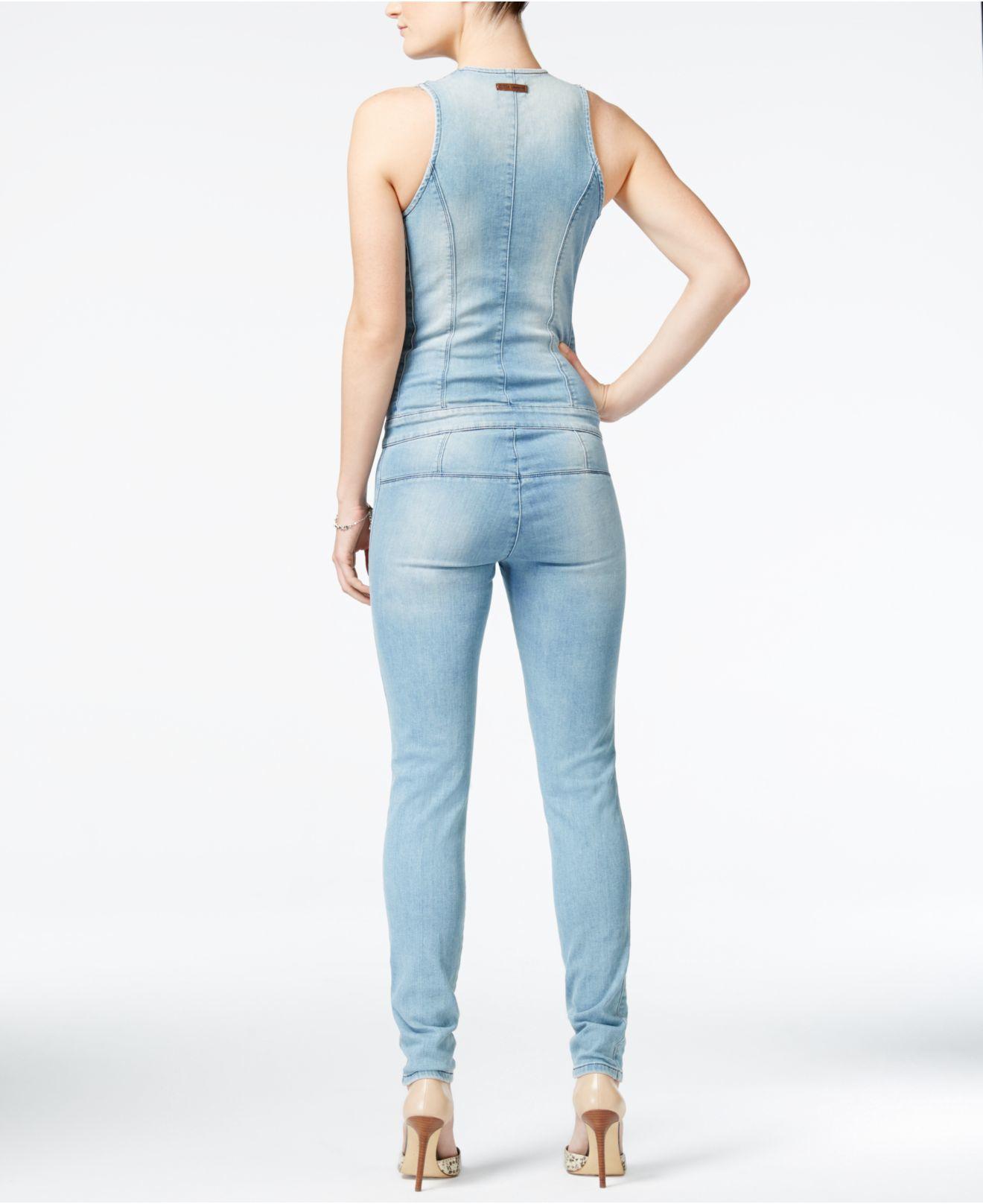 cf23e392bde8 Lyst - Guess Ripped Denim Zip-up Jumpsuit in Blue