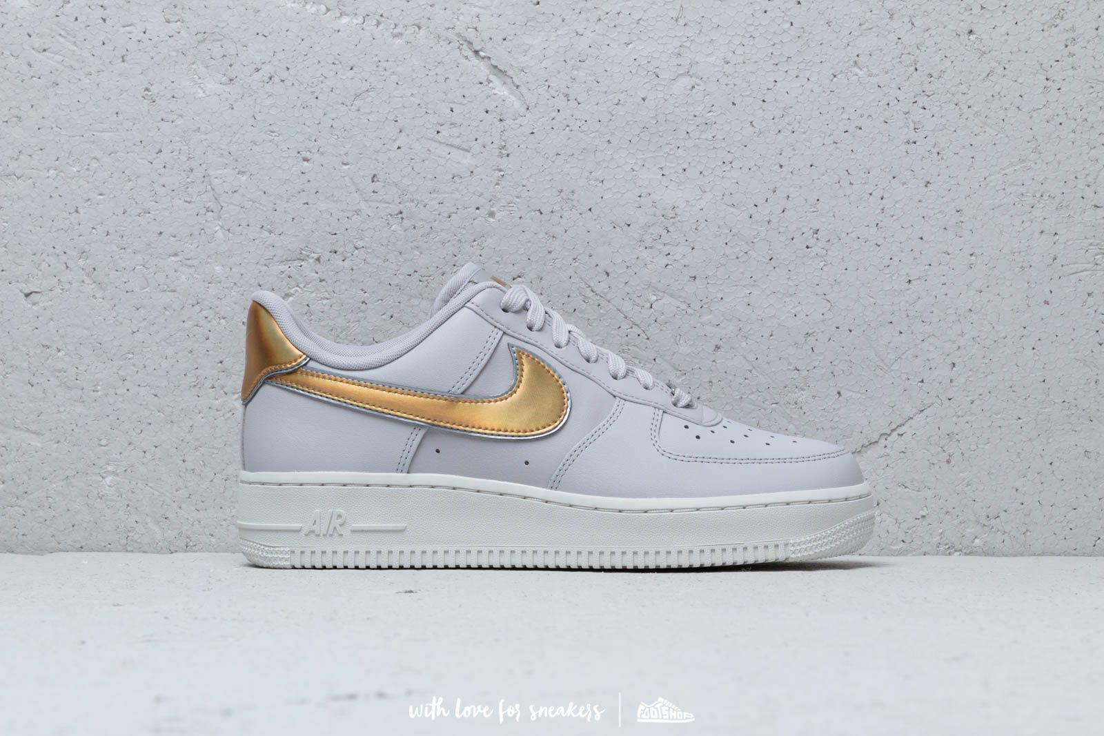 reputable site f6a61 cc1c2 Lyst - Nike Wmn s Air Force1  07 Metallic Vast Grey  Metallic Gold ...