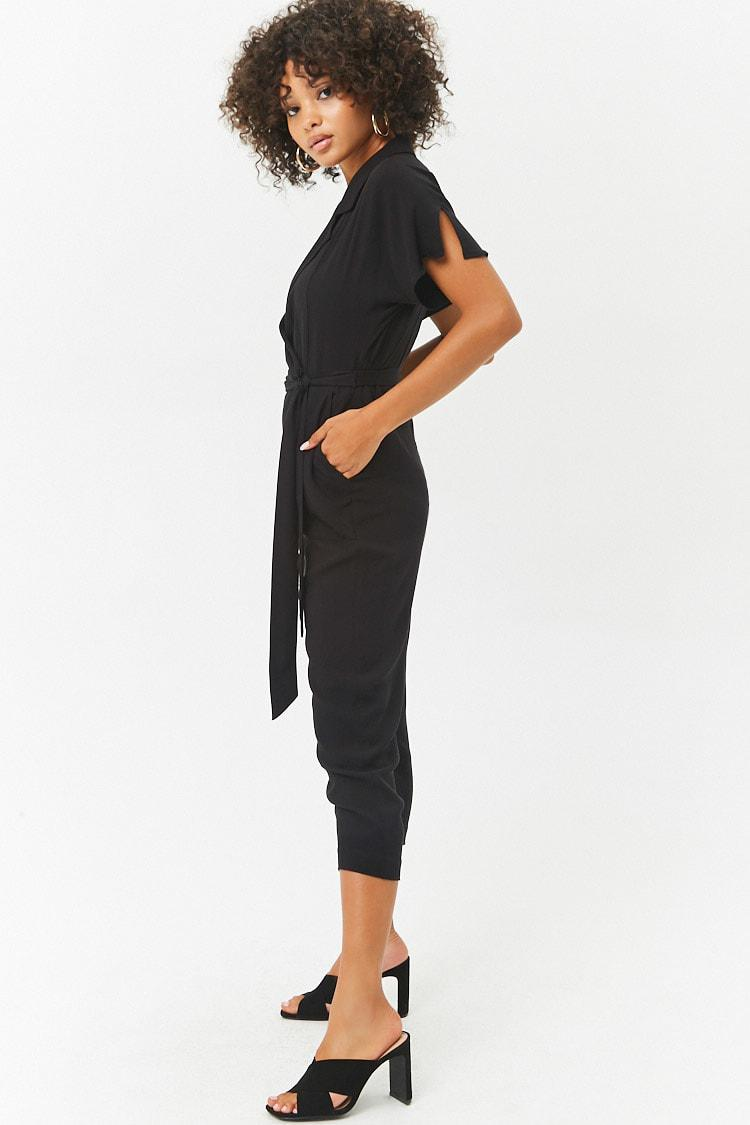 e0dd1ff81566 Forever 21 - Black Women s Plunging Surplice Dolman Sleeve Jumpsuit - Lyst.  View fullscreen