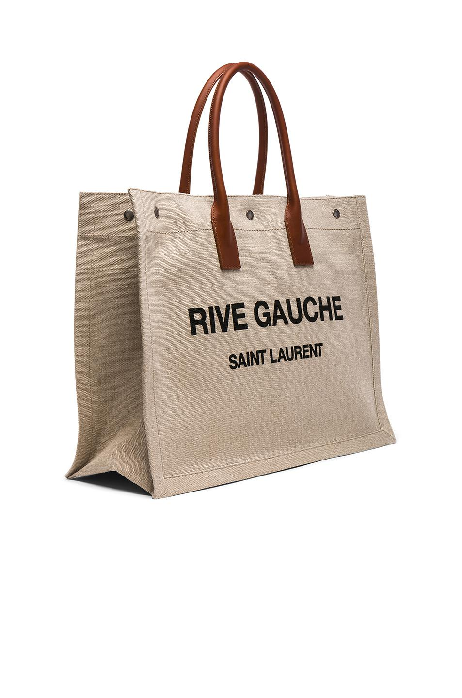 a3324d0605f0 Lyst - Saint Laurent Large Canvas   Leather Rive Gauche Noe Tote in ...