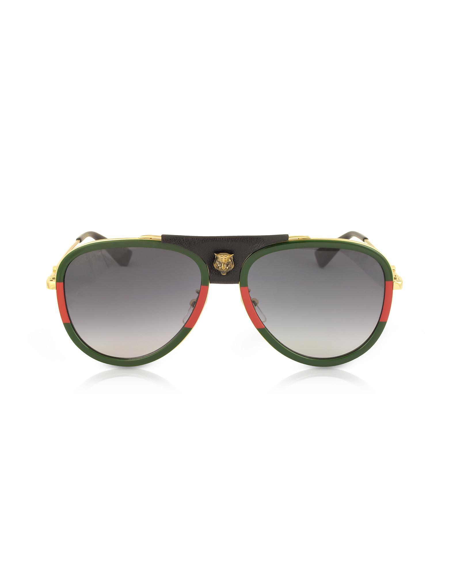 Gucci. Men s Metallic GG0062S Aviator Gold Metal And Black Leather  Sunglasses 75fe16bb6e
