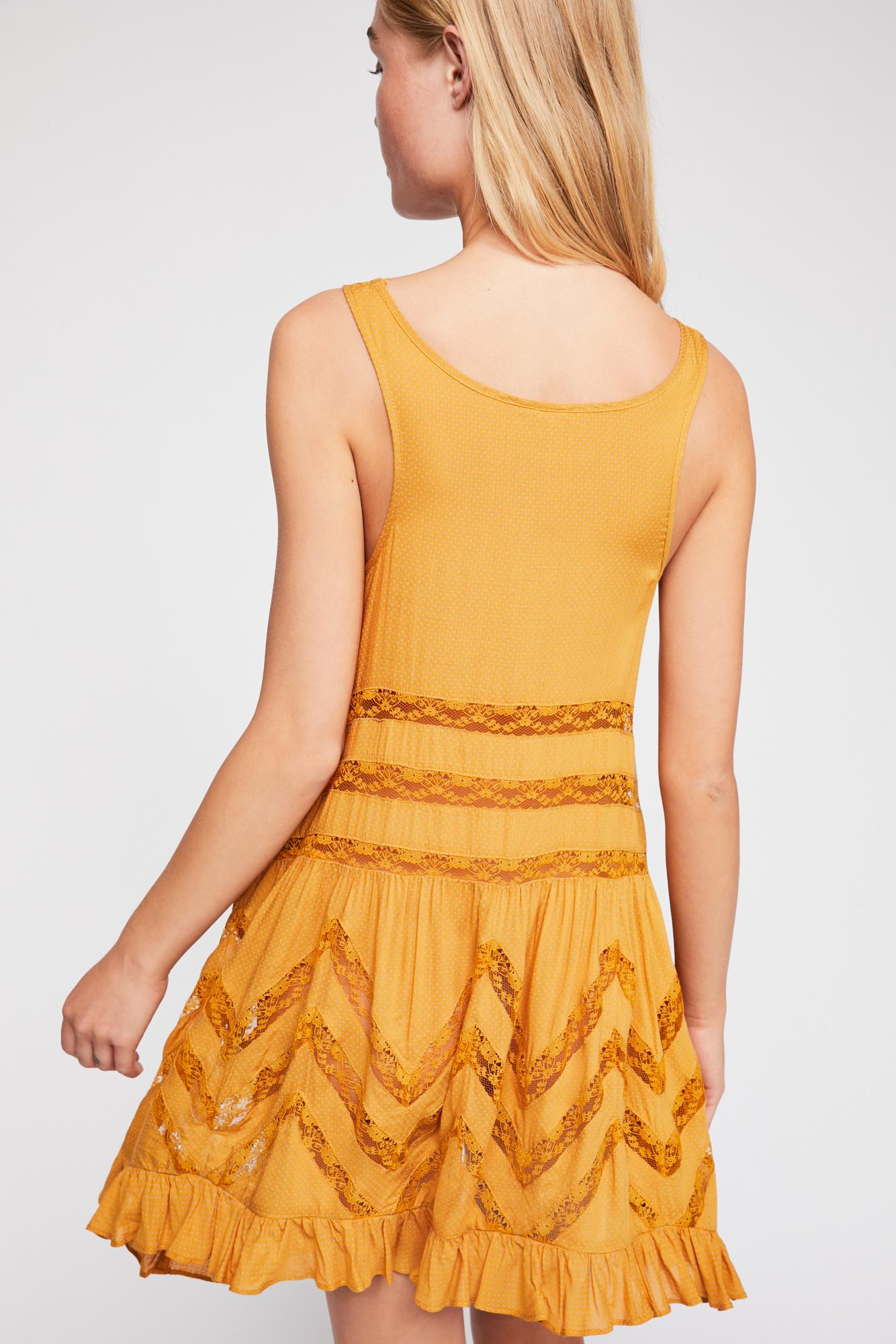 df542bb45dc3 Lyst - Free People Voile And Lace Trapeze Slip By Intimately in Yellow