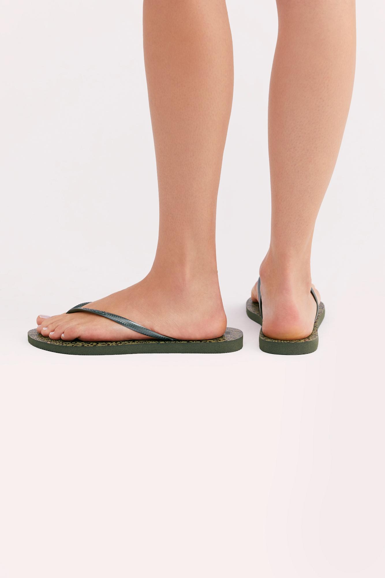 62652e578a63 Lyst - Free People Havaianas Slim Animal Thong Sandal in Green