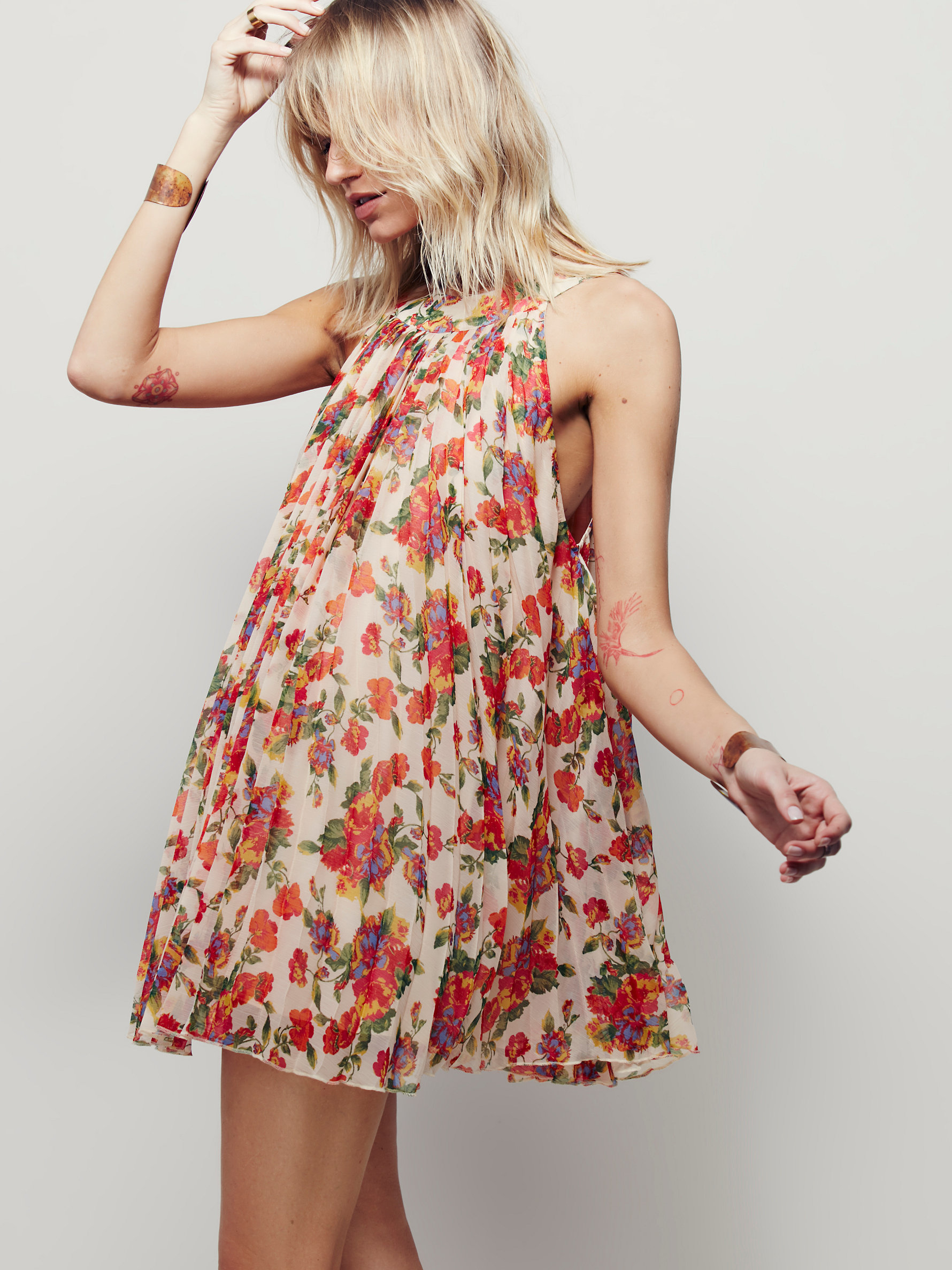 women's dresses for every moment. pleated dress with buttons. dress with contrasting buttons. combination ribbed dress. jacquard dress with metallic thread. cut out knit dress. striped dress. animal print halter dress. floral dress. jacquard dress with buttons. embroidered dress with pompoms.
