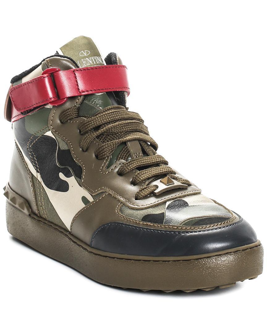 3f0a14258d4 Lyst - Valentino Garavani Camo Rockstud Leather High-top Sneaker ...