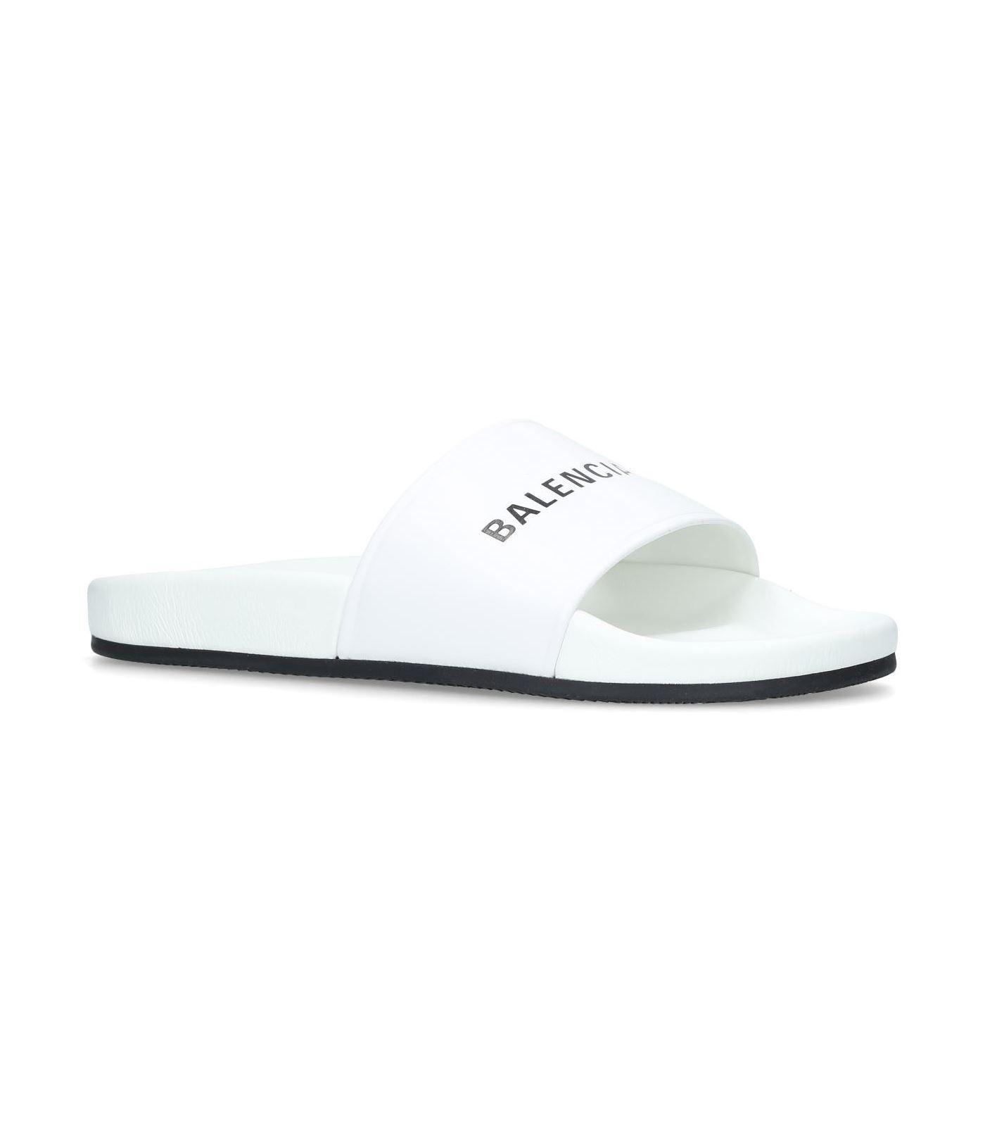 7185af950dde Lyst - Balenciaga Logo Pool Slides in White - Save 25%
